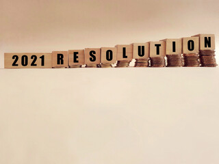 New Year's Concept - 2021 RESOLUTION text on wooden blocks background. Stock photo.