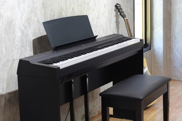 black piano on loft wall background
