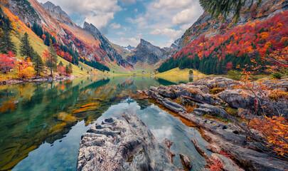 Landscape photography. Attractive morning view of Swiss Alps. Santis peak reflected in the calm surface of pure water of lake. Spectacular autumn scene of Seealpsee lake, Switzerland.