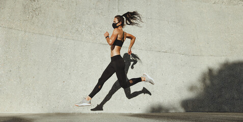 Fit woman sprinting outdoors