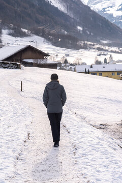 woman walking on a snow path in Switzerland