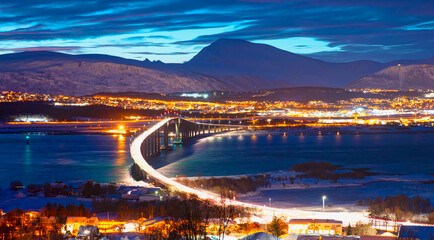 Beautiful or Urban landscape of Tromso in Northern Norway at twilight blue hour - Arctic city of Tromso with bridge -Tromso, Norway