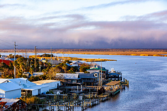 Apalachicola, Florida from the bridge over the Apalachicola River with purple storm clouds in the background.