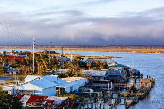 Downtown Apalachicola, Florida from the bridge with purple storm clouds in the background.