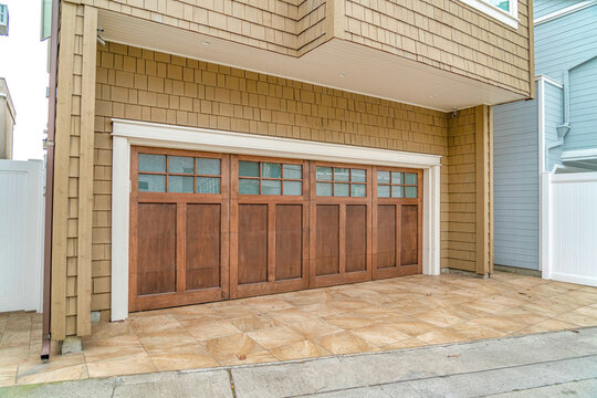 Glass paned wooden door of an attached garage of house in Long Beach California