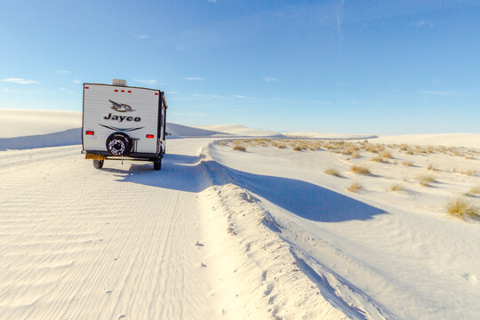 Alamogordo, New Mexico, USA - Jayco brand camper driving through the desert.