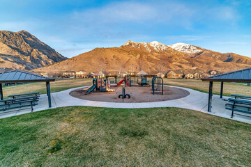 Playground in the middle of park with spectacular mountain and blue sky views