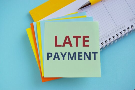 Late Payment text written on sticker note, Business concept of payment made to the lender after the due date has passed. blue background