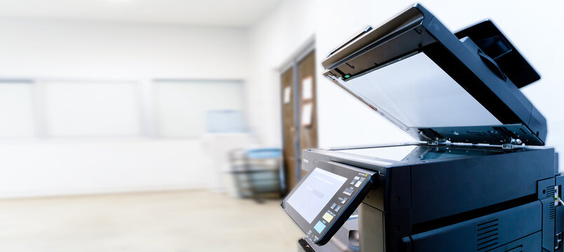 The photocopier or network printer is office worker tool equipment for scanning and copy paper.
