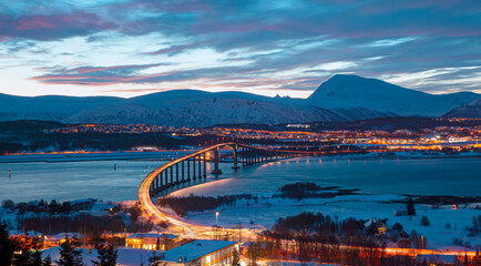 Beautiful winter or urban landscape of Tromso in Northern Norway at twilight blue hour - Arctic city of Tromso with bridge -Tromso, Norway