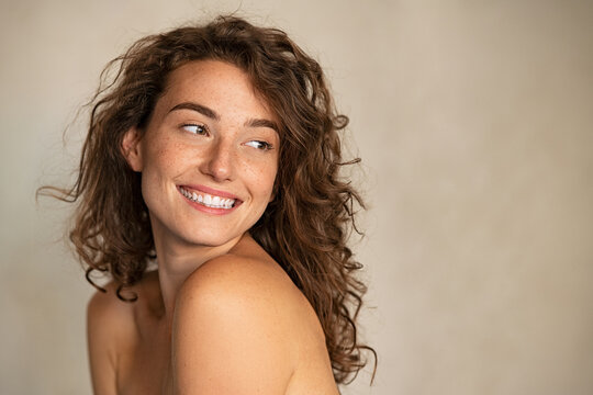 Smiling beauty woman with freckles looking away