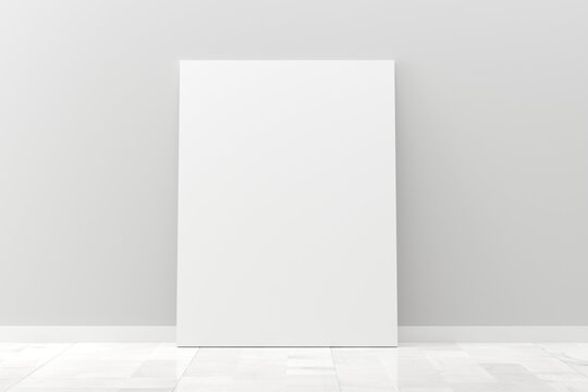 Empty picture frame canvas mock-up leaning against white wall in room with white wooden floor with copy space - portfolio, gallery or artwork template mock up