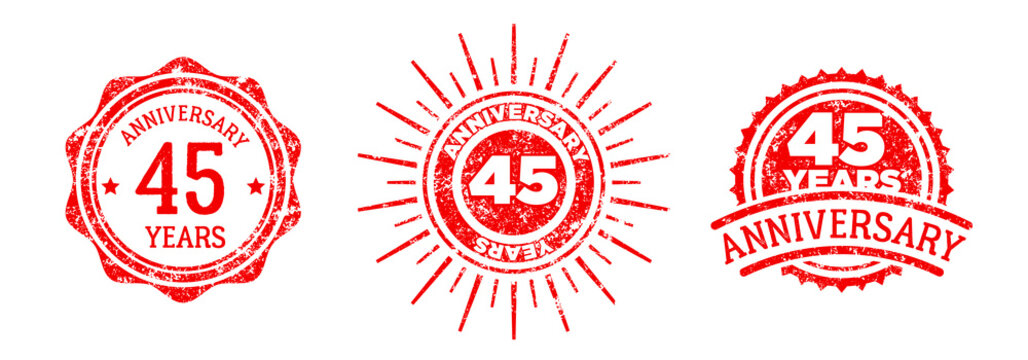 A group of 45 years anniversary logos drawn in the form of stamps, red frames for celebration. Grunge rubber stamp texture. Holiday stamps. Collection of postage stamps. Vector round stamps