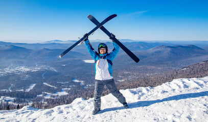 Happy skier man with ski background snowy sunny mountains, concept sport active winter
