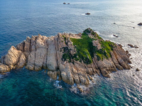 Small island and lighthouse off the coast of Cap Taillat in the mediterranean