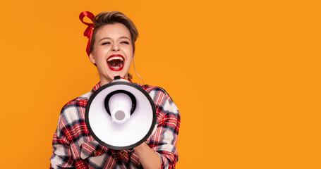 Smiling happy pinup woman screaming through megaphone.