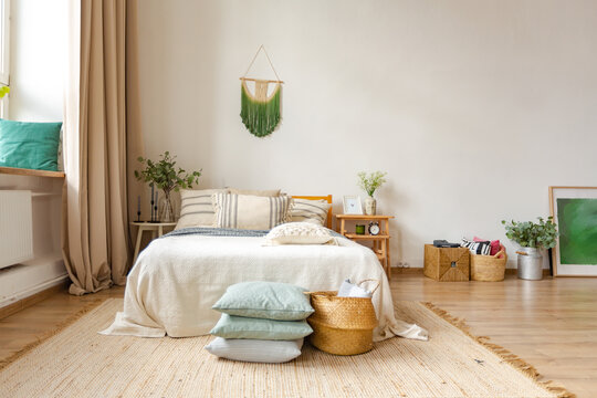 interior of stylish loft. spacious apartment with large windows, parquet on the floor and light walls. closeup view of shelving with different small things for decoration