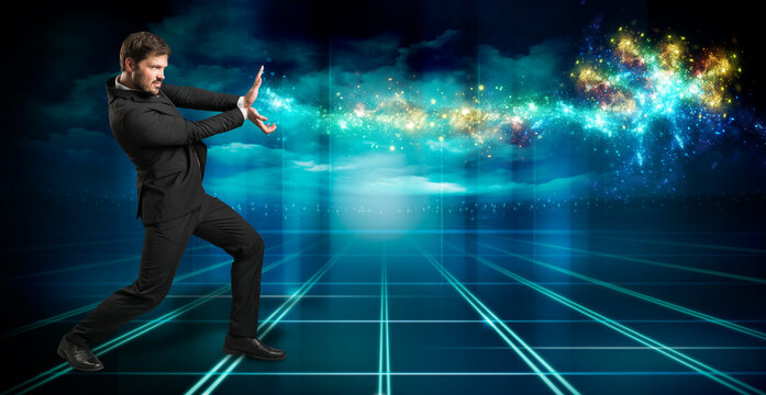 businessman firing sparkles like a superpower on blue background