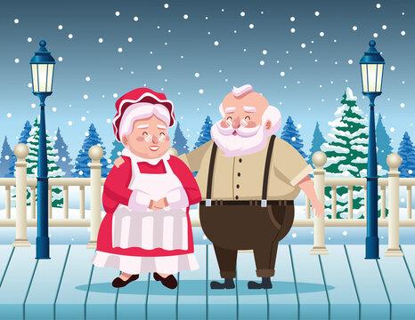 cute santa claus and wife in the snowscape scene
