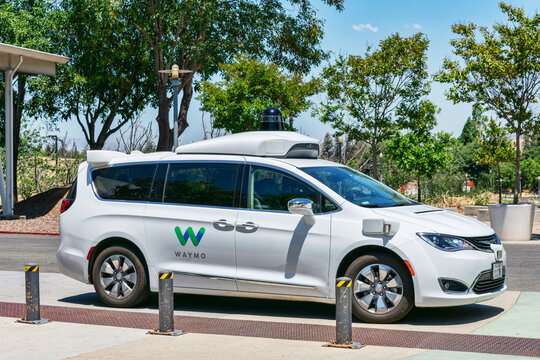 Waymo self driving car performing tests in a parking lot near Google headquarters. Waymo is a self-driving technology development company - Mountain View,California, USA - 2020
