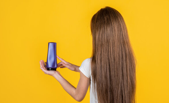 teen girl wash long straight hair with shampoo and condirioner, hairdresser