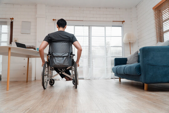 A disabled man sitting in a wheelchair is disappointed and Desperate to heal after car accident. Concept of Careless Driving, Insurance and Mental health care After the accident