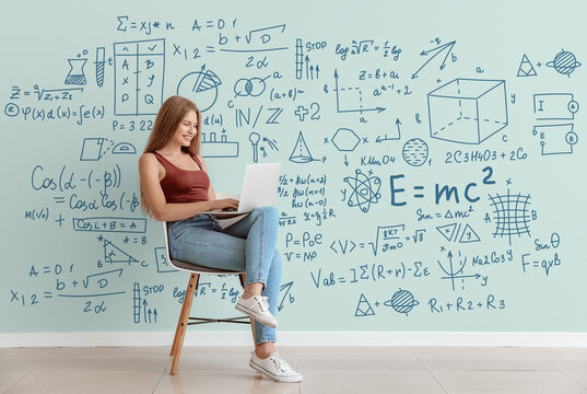 Young woman with laptop studying exact mathematical sciences. Concept of online education