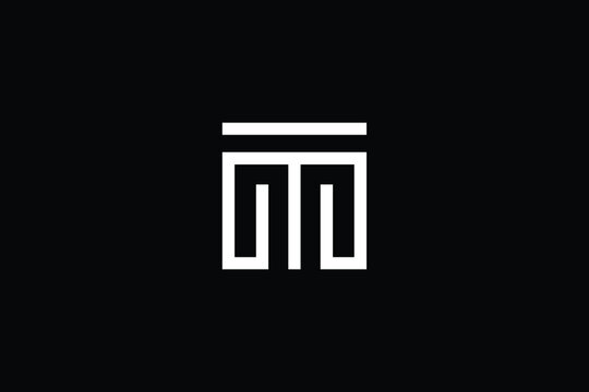 TM logo letter design on luxury background. MT logo monogram initials letter concept. TM icon logo design. MT elegant and Professional letter icon design on black background. M T MT TM