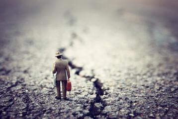 Fototapeta premium Surreal image of mysterious man walking alone in urban environment