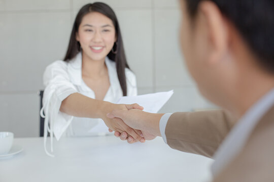Close up hand man and woman shaking hands agreement success for connection and partner. Business concept.