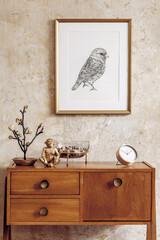 Stylish living room with vintage commode, gold mock up photo frame, gold clock, decoration, grunge...
