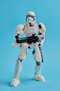 """Russia, St. Petersburg, January, 2021: Imperial soldier stormtrooper, with an E11 blaster and a submachine gun ready to attack. Character of the Saga """"Star wars"""" on pastel blue background"""
