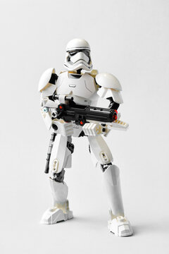 Russia, St. Petersburg, January, 2021: Imperial soldier stormtrooper, with an E11 blaster and a submachine gun. A character from the Star Wars saga on a light gray background