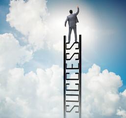 Businessman climbing the career ladder of success