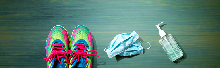 Fitness and coronavirus theme with running shoes - flat lay
