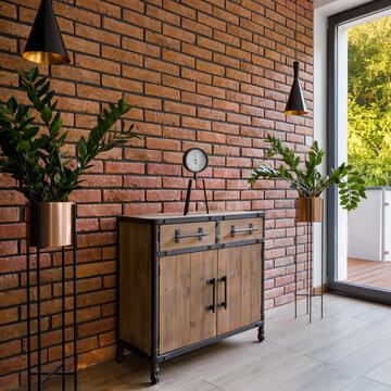 Wooden side board and brick wall