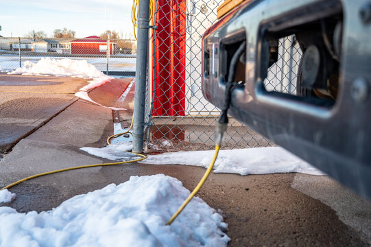Focus on power cord feeding to a engine block heater