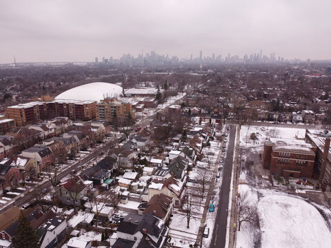 An aerial drone image over the East York neighbourhood of Toronto and Monarch Park in winter.