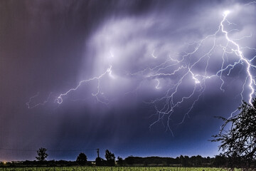 Lightning thunderstorm flash concept weather cataclysms hurricane tornado storm flashes in the...