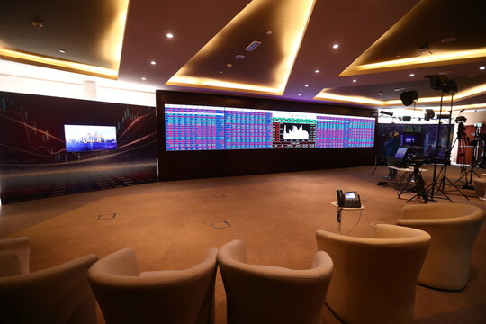 An empty room with an electronic board displaying data is seen amid the coronavirus disease (COVID-19) outbreak at Doha Stock Exchange in Doha
