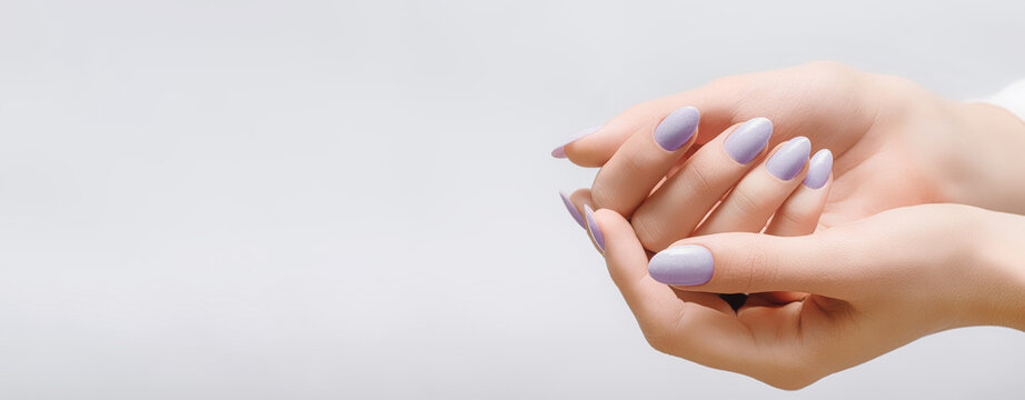 Female hands with rose nail design. Pink glitter nail polish manicure on white background. Nail design copy space.