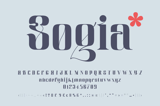 Serif style alphabet and numbers set with elegant line decoration.