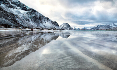 Lofoten Islands. Beautiful landscape. Sea against the backdrop of mountains and clouds.