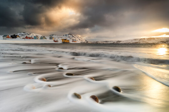 Storm clouds at dawn over waves of the Arctic icy sea, Veines, Kongsfjord, Varanger Peninsula, Troms og Finnmark, Norway, Scandinavia, Europe