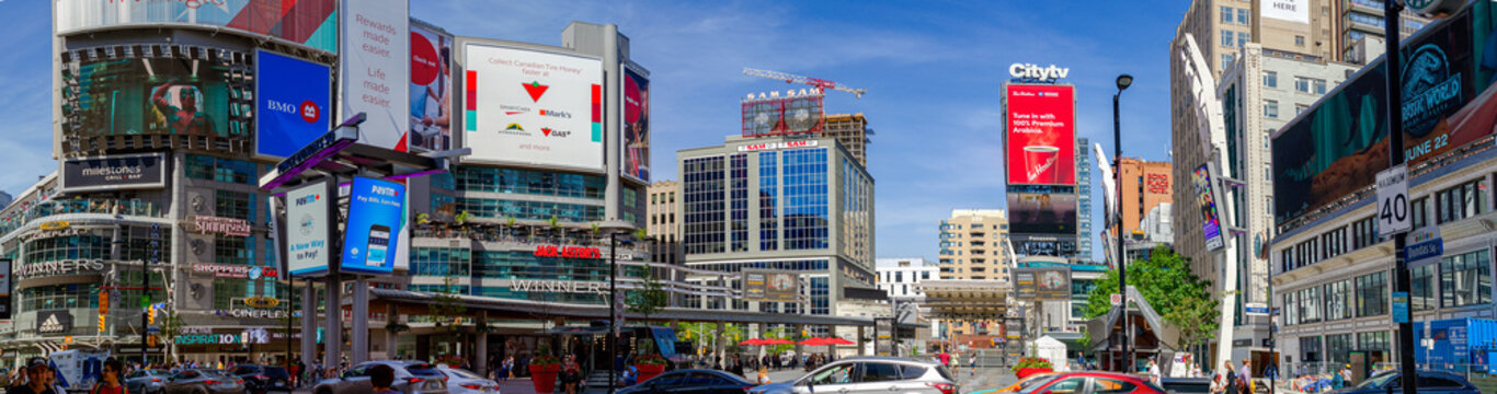 Toronto, ON, Canada - Jun 12, 2018: Yonge-Dundas Square is a commercial, public square, that hosts many events, and it is one of Toronto's main attraction, full of luminous screens and lights.