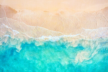 Top view aerial drone photo of ocean seashore with beautiful turquoise water and sea waves. Caribbean resort. Vacation travel background. - fototapety na wymiar