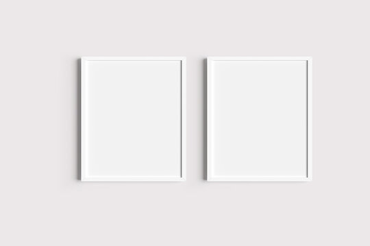 Set of two white portrait picture frame mockups