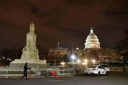 Security forces patrol as the streets near the Peace Monument and the U.S. Capitol are empty after a curfew in Washington
