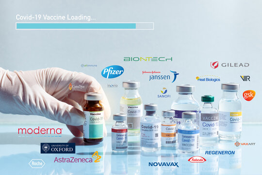 World fight, hope and progress to develop Covid-19 Vaccine concept. Hand of a researcher take a 2019-nCov vaccine vial with loading bar and Pharmaceutical company logo, UK, USA