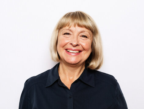 Portrait of senior woman with cute smile over white background